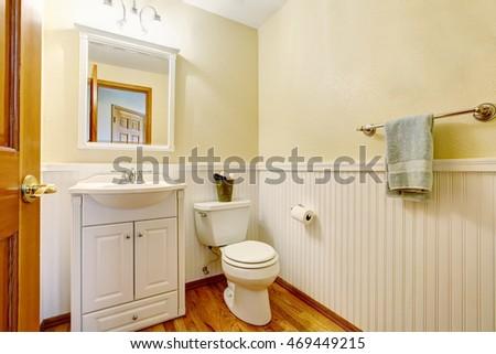 Simple bathroom interior with white vanity cabinet and hardwood floor. Northwest, USA #469449215