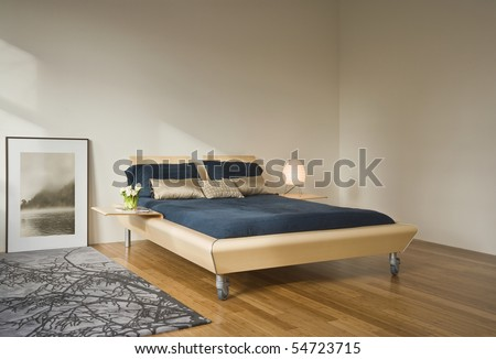Simple Bedroom View With A Bed And Artwork Sitting On The