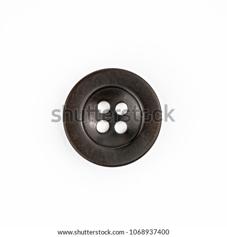 Simple black clothes button from above.