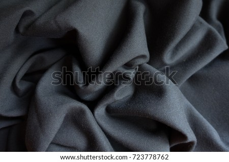 Simple black viscose fabric in soft folds #723778762