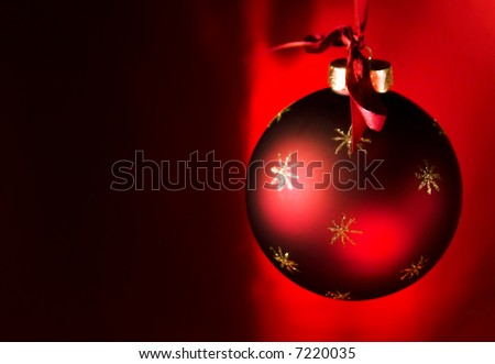 Simple Christmas Bauble with dark / red background