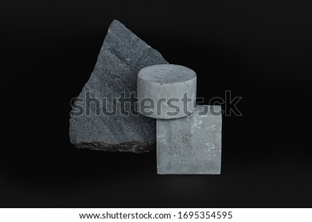 Photo of  Simple concrete figures located on a dark background