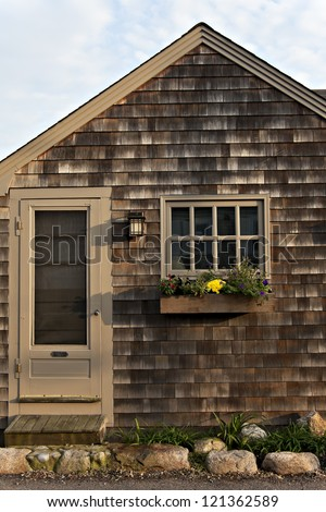 Simple craftsman style cottage with wood shingles and for Craftsman style window boxes