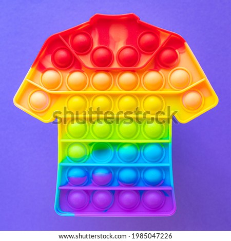 simple dimple pop it anti-stress sensory toy burst me popit entertainment children, leisure free time background multicolored bright colorful game Foto stock ©