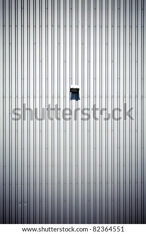 Simple empty steel factory wall with lamp