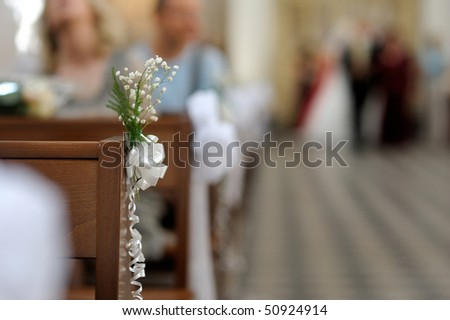 stock photo Simple flowers wedding decoration in a church