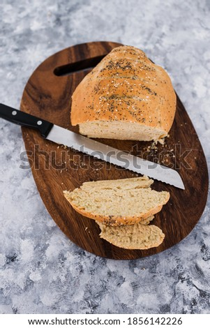 simple food ingredients concept, homemade australian damper bread without yeast freshly made and on top of cutting board  Stockfoto ©