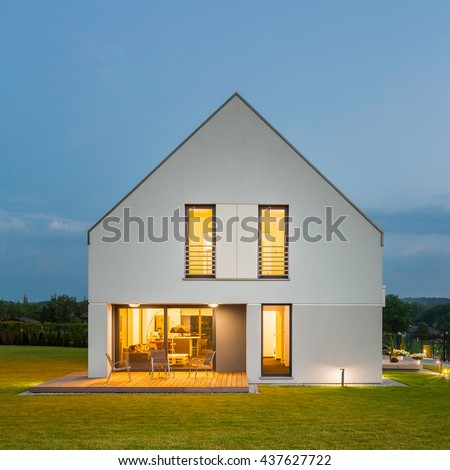 Simple form white house with beauty landscape, at night #437627722