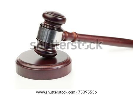 Simple gavel in action on a white background