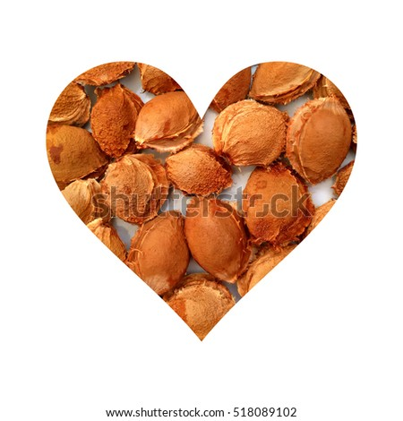 Simple heart filled with apricot stones texture #518089102