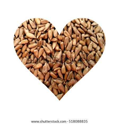 Simple heart filled with peeled sunflower seeds texture #518088835