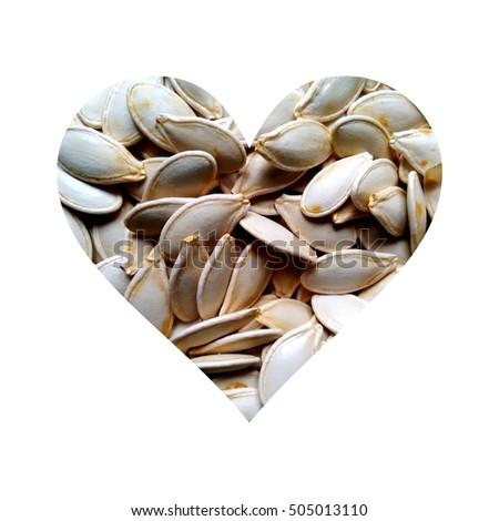 Simple heart made from pumpkin seeds texture #505013110