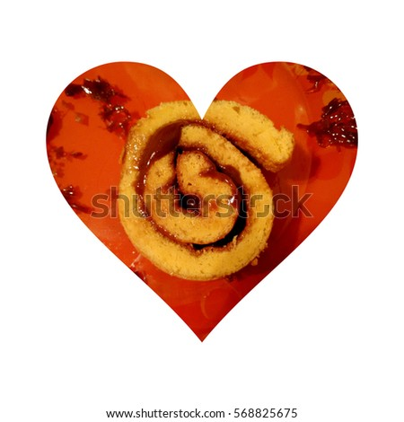 Simple heart shape, having inside one slice of sponge cake roll filled with chocolate, on white background #568825675