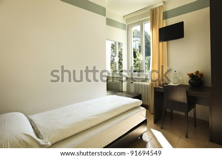simple hotel room, single bed