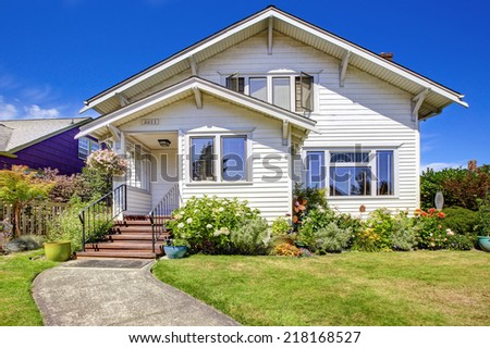 Simple house with  blooming flowers, Entrance porch with stairs and railings #218168527