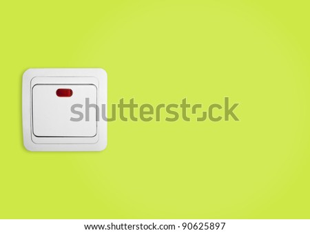 Simple light switch on a green wall