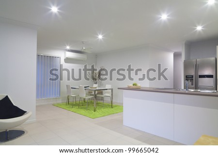 Simple living room and kitchen in new suburban house.