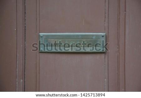 Simple metal door mail slot with a czech sign 'Listy' Zdjęcia stock ©