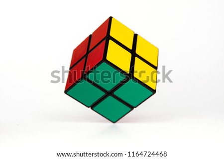 Simple mind challanging puzzle, rubik kind of cube hovering over white background, simplicity, ease