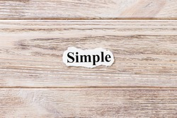 Simple of the word on paper. concept. Words of Simple on a wooden background.