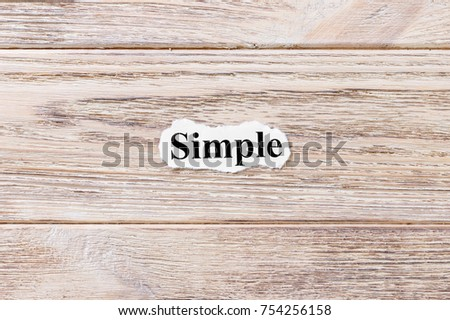 Simple of the word on paper. concept. Words of Simple on a wooden background. #754256158