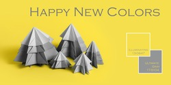 Simple origamy 3D Christmas tree made from gray paper on yellow backround. Yellow and Gray Colors new colors of 2021 year. Text Happy New Colors