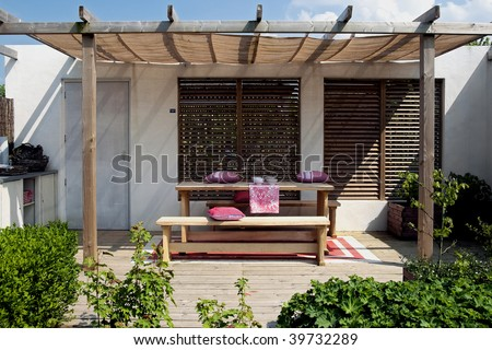 simple outside living place with wood elements and red touch