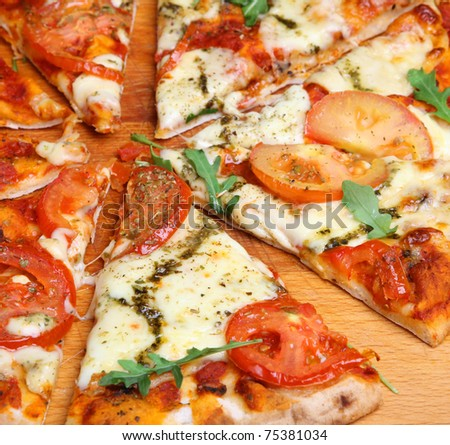 Simple Pizza With Mozzarella Cheese, Tomatoes And Pesto. Stock Photo ...