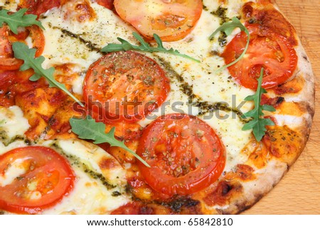 Simple Pizza With Tomato, Mozzarella, Pesto And Olive Oil. Stock Photo ...