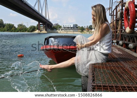 Simple pleasures, happy life ,barefoot woman touching water enjoying summer and sun