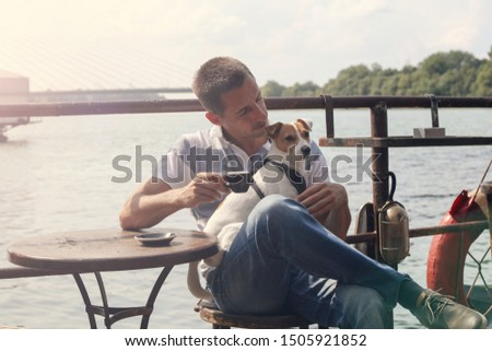 Simple pleasures, happy life, man enjoying man enjoying drinking coffee spending time time with dog