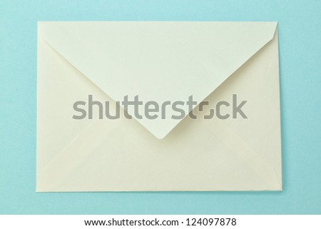 Simple postal envelope on a blue background.