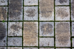 Simple rectangular paving slabs. Gray paving tiles details close-up. The texture of paving tiles, the pattern on the tile. Concrete paving slab flagstone. Sidewalk pavement pattern. Cement brick