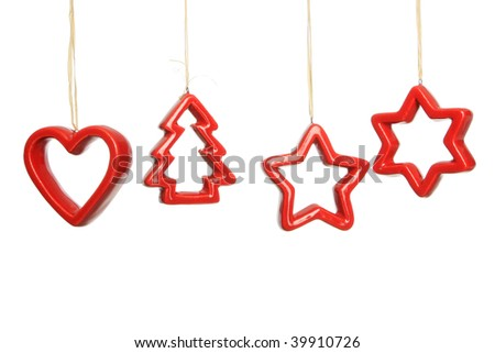 Simple red christmas decorations hanging against a white background