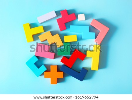 Simple solutions to decide problems. Strategy in business. Wooden cubes on a blue background as a puzzle symbol. The challenge with a difficult solution