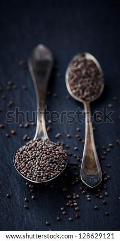 Simple still life with black mustard seeds