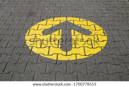 Simple straightforward solution concept: Yellow arrow in circle on paving blocks showing direction straight ahead Сток-фото ©
