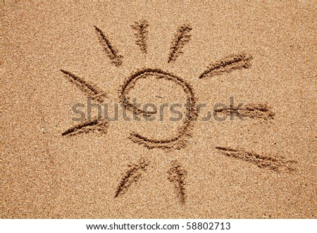 Simple sun drawing on the sand