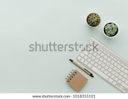 Simple Trendy Office Desk with keyboard, eco craft office elements and potted flower. Home Office Desktop
