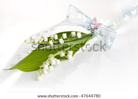 Simple twig of lilly of the valley with a soft pastel bow