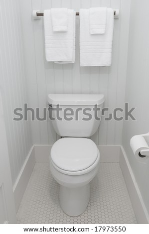 Simple white bathroom toilet lid down