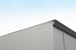 Simple White Concrete Building Corner for Sale or Loan, Basic Minimal Shape Abstract Exterior Warehouse or Construction Element Concept, Blue Sky and Cloud in Background with Copy Space
