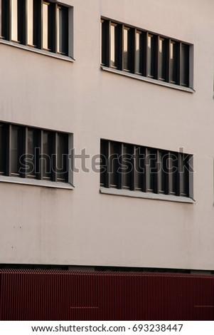 Simple windows on a simple building #693238447