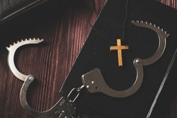 Simple Wood Cross and Unchain Handcuffs. Concept of Jesus Christ the Savior Liberate People from Sin.