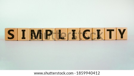 Simplicity concept. Wooden cubes with word 'simplicity'. Beautiful white background. Business and simplicity concept, copy space. Foto d'archivio ©