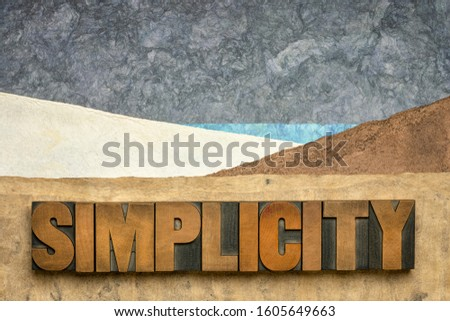 simplicity word  in vintage letterpress wood type against abstract paper landscape, minimalism concept