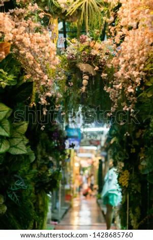 Simulation flowers simulation trees store within the Chatuchak weekend market. Bangkok, Thailand.