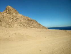 Sinai desert backgound with mountains and Red Sea, deserted landscape