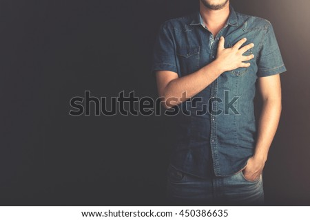 sincere man swearing with hand on heart #450386635
