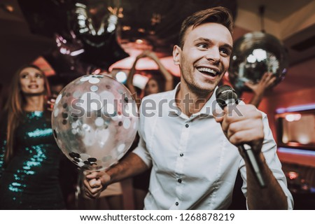 Sing in Karaoke. Men. Have Fun. Great Mood. Balloon. Karaoke Club. Celebration. Dance Club. Holidays Concept. Dancing People. Young People. Sing.Microphone.Modern Nightclub. Party Maker. Birthday.Men.